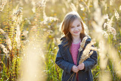 Portrait of a cute little girl on autunm day Royalty Free Stock Photos