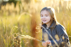 Portrait of a cute little girl on autunm day Royalty Free Stock Photo