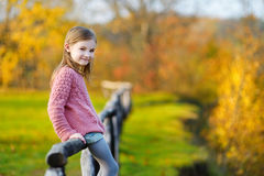 Portrait of a cute little girl on autunm day Royalty Free Stock Images