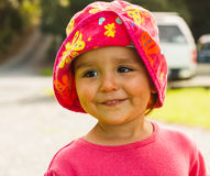 Portrait of cute little girl with big eyes. Portrait of a cute little girl with big eyes and in hat,photo took in New Zealand, photo is usable on picture post Stock Photos