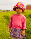 Portrait of cute little girl with big eyes. Portrait of a cute little girl with big eyes and in hat,photo took in New Zealand, photo is usable on picture post Royalty Free Stock Photos