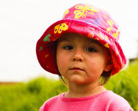 Portrait of cute little girl with big eyes. Portrait of a cute little girl with big eyes and in hat,photo took in New Zealand, photo is usable on picture post Royalty Free Stock Images