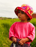 Portrait of cute little girl with big eyes. Portrait of a cute little girl with big eyes and in hat,photo took in New Zealand, photo is usable on picture post Royalty Free Stock Photo