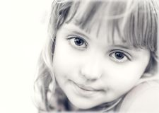 Portrait of a cute little girl in black and white royalty free stock photos