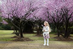 Portrait of cute little girl with blonde hair outdoor. Spring season stock image