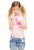 Portrait of a cute little girl blowing soap bubbles Royalty Free Stock Image