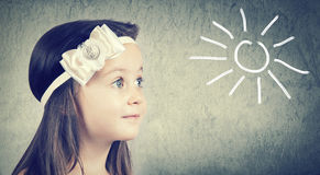 Portrait of a cute little girl with blue eyes Stock Photos