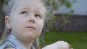 Portrait of cute little girl with blue eyes stock footage