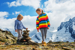 Portrait of a cute little girl and boy outdoors Royalty Free Stock Photo