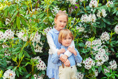 Portrait of a cute little girl and boy outdoors Royalty Free Stock Images