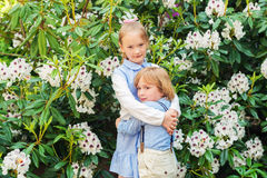 Portrait of a cute little girl and boy outdoors Stock Photos