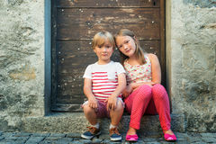 Portrait of a cute little girl and boy outdoors Royalty Free Stock Photography