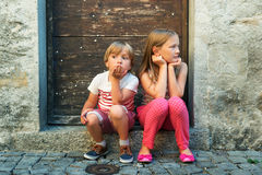 Portrait of a cute little girl and boy outdoors Stock Photo