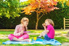 Portrait of a cute little girl and boy outdoors Stock Photography