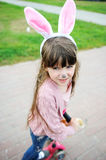 Portrait of cute little girl with bunny ears Stock Photos
