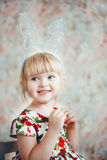 Portrait of a cute little girl with bunny ears. Royalty Free Stock Image