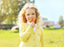 Portrait cute little girl child with caramel Stock Photography