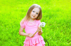 Portrait of cute little girl child in dress with dandelion. Flower in summer day Royalty Free Stock Images