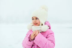 Portrait of cute little girl child looking away in winter Royalty Free Stock Image