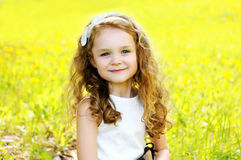 Portrait of cute little girl child outdoors in sunny summer Stock Photography