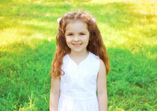 Portrait of cute little girl child outdoors in sunny summer Royalty Free Stock Photos