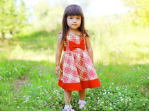 Portrait of cute little girl child wearing a red dress Royalty Free Stock Images