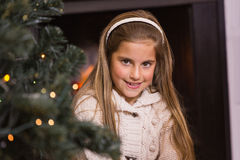 Portrait of a cute little girl at christmas. At home in the living room Royalty Free Stock Photos