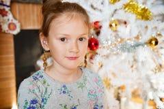 Portrait of a cute little girl. Close up portrait of a cute little girl playing with Christmas toys Stock Photos