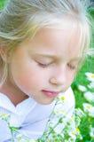 Portrait of a little girl with daisy. Portrait of a cute little girl with daisy Royalty Free Stock Photos