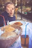 Little girl eating pasta spaghetti stock photos
