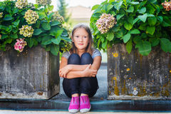 Portrait of a cute little girl. Fashion portrait of a cute little girl of 7-8 years old, wearing bright pink shoes Stock Images
