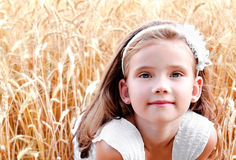 Portrait of cute little girl on field of wheat royalty free stock photos