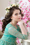 Portrait of a cute little girl in a flower wreath Royalty Free Stock Images