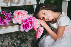 Portrait of a cute little girl in the garden Royalty Free Stock Photo