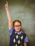 Portrait of cute little girl gesturing pointing upwards Stock Images