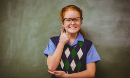 Portrait of cute little girl gesturing thumbs up Royalty Free Stock Images