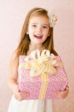 Portrait of cute little girl with gift box Royalty Free Stock Images