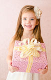 Portrait of cute little girl with gift box Stock Photography