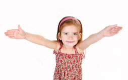 Portrait of cute little girl giving her hands isolated Stock Photo