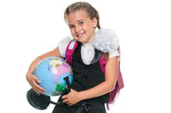 Portrait of a cute little girl with globe. Education and school concept - little schoolgirl with globe and backpack on white background Royalty Free Stock Photography