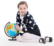 Portrait of a cute little girl with a globe. Portrait of a cute little girl with a globe - isolated on white Royalty Free Stock Photo