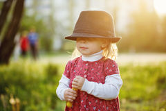 Portrait of cute little girl in hat. Spring. Stock Images