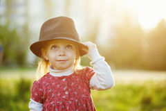 Portrait of cute little girl in hat. Spring. Stock Image