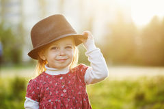 Portrait of cute little girl in hat. Spring. Royalty Free Stock Image