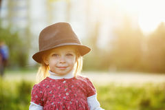 Portrait of cute little girl in hat. Spring. Royalty Free Stock Photos