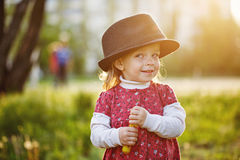 Portrait of cute little girl in hat. Spring. Stock Photography
