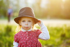 Portrait of cute little girl in hat. Spring. Royalty Free Stock Images
