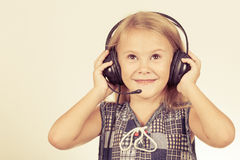 Portrait of cute little girl with headphones on her head Royalty Free Stock Photo