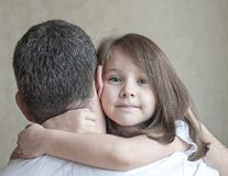 Portrait of cute little girl held in father`s arms. Happy loving family. Father and his daughter child girl playing hugging royalty free stock image