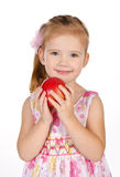 Portrait of cute little girl holding an apple Royalty Free Stock Photography